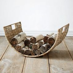 A beautiful addition to the hearth, this wicker log basket holds abundant kindling for fireside evenings.- Wicker- Indoor or sheltered outdoor use- Firewood Basket, Firewood Storage, Firewood Holder, Cape Cod Style House, Log Holder, Log Home Interiors, Cozy Cabin, Winter House, Fall Decor