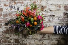 Kumquats, snapdragons and winter foliage  Winter bridal by Pistil & Stamen Flower Farm and Studio
