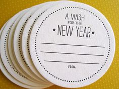 Coasters That Will Impress for a New Year's Eve Bash - great idea, to late to order them? Just have your guests write them on a piece of paper.