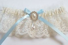 Ivory Garter with Satin Ribbon Bow Topped by Pearl and Crystal Detail, Incl Satin Band Toss - The MARISOL Garter