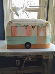 Vintage Caravan Sewing Machine Cover. I'd love to work on my blog www.sewinlove.com.au in an office like this.