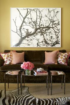 Large art over the sofa and colorful throw pillows.