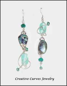 This is a beautiful pair of Sterling Silver Asymmetrical earrings accented with Abalone,Glass and freshwater pearls. They measures 3 inches long and 1/2 of an inch wide. Each piece is a one of a kind wearable art work for the individualistic woman! All items are made in my home studio in Massachusetts. All items come in a jewelry box for gift giving | Shop this product here: http://spreesy.com/CreativeCurvesJewelry/2 | Shop all of our products at http://spreesy.com/CreativeCurvesJewelry…