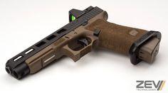 Glock 34 with Zev Dragonfly cut (on factory slide) with FDE frame and basepad. Zev slim magwell