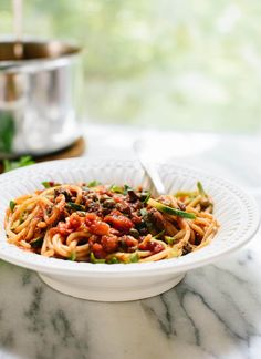 Learn how to make spaghetti alla puttanesca, perfect for easy weeknight dinners! cookieandkate.com