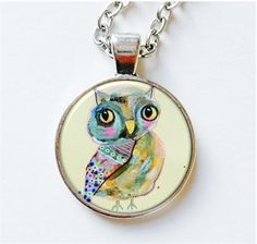 Here is one of my cute mixed media owl paintingswhich I have turned into a quirky pendant.    All of my art jewellery iscarefully and lovingly assembled for you in my studio. Images are printed onto quality gloss paper with Epson inks and then set in a bezel sealed under a lightweight resin dome. Your pendant, which measures 1 inch in diameter, has a20 inch chain and comes in an attractive organza bag.   IIII ALSO AVAILABLE AS EARRINGSIIII See listing here…