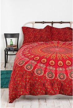 Tapestry Medallion Duvet Cover in red. I would love to accent this with teal and orange throw pillows =)