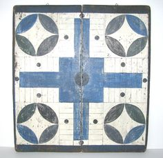 Wonderful early-mid 20thC. folding parcheesi gameboard, in predominately blue and white with with black, green and grey paint. The board itself is probably late 19thC., though the paint was applied later. A wonderfully folky and graphic board in very good condition.