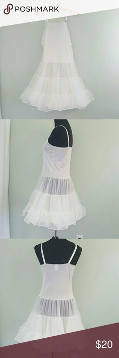 Vintage White Petticoat Crinoline Slip Dress XS 32 Good Condittion. This so unique. The top is a slip with a tiny rosebud applique and has an attatched petticoat. Bust is 32. The shoulder straps are adjustable Length from top of the bust is 30. Shown on a 34B size 6 Dress form. Best fit 2. There is a tiny faint pink mark to the bust that is so light it wouldnt photo. May come out with bleach. ModCloth Intimates & Sleepwear Chemises & Slips