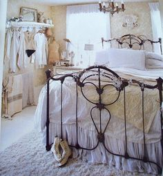 An old iron bed is all that's needed to bring contrast to this otherwise washed out bedroom.
