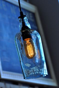 Recycled Old Antique Beach Glass Liquor Wine Hanging Bottle Lamp Pendant Light. $79.00, via Etsy.