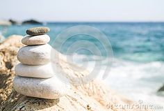 orizontal image of relaxing Balance  stones with the sea in background