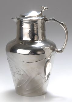 Dutch Art Nouveau covered jug, c. 1900, pewter, sold under the trade name Urania, marked URANIA HOLLAND 1073, design attributed to Friedrich Adler, 22.5 cm H.