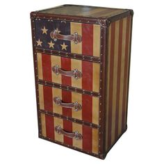 "Four-drawer chest with an American flag motif and faux leather trim.   Product: ChestConstruction Material: Wood and faux leatherColor: MultiFeatures: Four drawersDimensions: 34"" H x 20.5"" W x 17"" D"