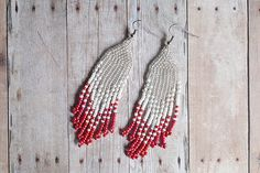 Beautiful hand-beaded seed bead tassel earrings with an ombre color scheme. The tips are a bright, iridescent pink-orange color. Wear out on date night or to the office. They are very versatile! Dimensions: (approximate) Drop length : 3 1/4 in (without earring hook) Width : 1 in