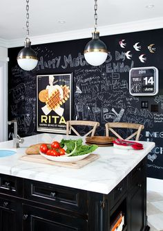 Hicks pendants + chalkboard wall + marble island in kitchen via Ashley Capp