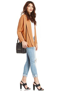 rust colored boyfriend blazer. It's a luxurious piece that goes perfect with a simply white tee and a pair of distressed jeans