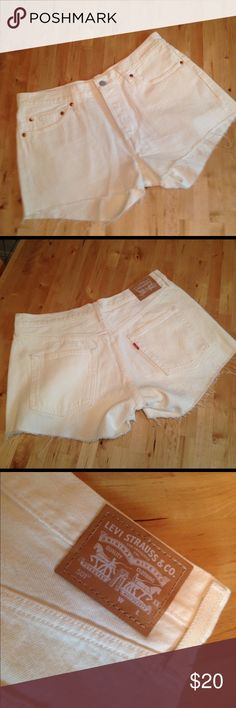 White Levi's cut-off shorts Never been worn. These were manufactured as cut-offs (not homemade). Levi's Shorts Jean Shorts