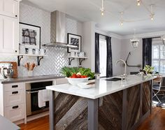 Kitchen by Sarah Richardson. I love what she did with the subway tile. She used a gray grout - which is genius. Neutral, but not boring.  Love the island