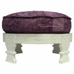 "Moroccan-inspired ottoman with a detailed wood frame and removable cotton cushion. Made in India.  Product: OttomanConstruction Material: Wood and cottonColor: Lilac and creamFeatures:  Made in IndiaRemovable cushion Dimensions: 15"" H x 30"" Diameter"