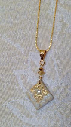 Handmade polymer clay Swarovski crystal diamond bridal wedding pendant necklace metallic gold white. $25.00, via Etsy.