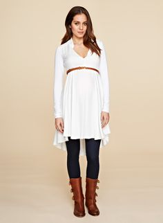 This white tunic by Isabella Oliver is perfect paired with black leggings and boots. #maternity