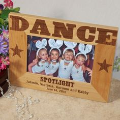 """Wood Dance Personalized Girls Picture Frames. A picture of your Dance team looks great in this Personalized Dance Picture Frame. Our Personalized Dance Picture Frame makes a unique gift idea for any Dance team or coach and Christmas. Our Personalized Dance Wooden Picture Frame measures 8¾""""x 6¾"""" and holds a 3½"""" x 5"""" or 4"""" x 6"""" photo of your favorite Dance Personalized Dance photo frame includes an easel back allows for desk display."""