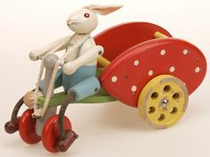 ancien jouet à tirer // vintage pull toy ✭ bunny on cycle, 1950s ✭ via Musée du Jouet de Bruxelles ✭ mid century kids design
