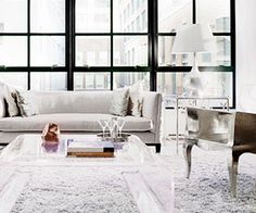 magnificent windows, a gray shag carpet, and a Lucite coffee table // living rooms