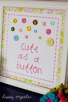 "I agree with the previous comments on having guests glue buttons on something: ""I like the look of this with the idea to build it as part of a baby shower. Have a plainer version and a tin of buttons so guests can each glue buttons to the book cover, then write a welcome message to baby inside. Great keepsake for later."""