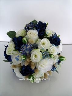 Hand made blue crystal clusters and brooches amongst stunning silk flowers. Home Decor Floral Arrangements, Crystal Cluster, Blue Crystals, Artificial Flowers, Silk Flowers, Shades Of Blue, Brooches, Wedding Flowers, Floral Wreath