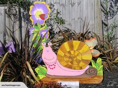 FiFi the snail with a large lovely Flower prop.
