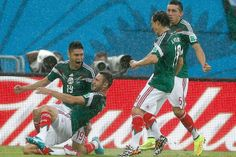 Mexico's Oribe Peralta, left, celebrates with teammates Miguel Layun, Andres Guardado and Hector Herrera after scoring the match's only goal. 13/06/14