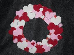 Valentines Day heart wreath - made from craft foam hearts (buy or cut out yourself), cardboard (diaper box!), tissue paper, glue stick or just glue, ribbon, stapler (ribbon and stapler for making the hanger part)