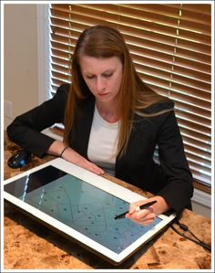 Ruth using a Yiynova map digitizer. Pen and gesture controlled displays increase productivity