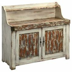 """This could be used in a kitchen, dining space or covered porch area. Priced at $779.95. Weathered wood credenza with a display ledge and bottom cabinet. Product: CabinetConstruction Material: WoodColor: Antique ivory and brown Features: Display ledgeTwo doorsDistressed finish Dimensions: 42.5"""" H x 48.5"""" W x 20.75"""" D"""