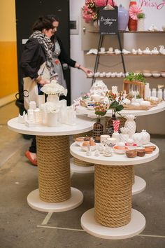 Tables of different heights made from repurposed materials | rope table display. miss jones
