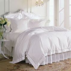 Everyone loves an all-white bed, but this is not your normal bedding. Expertly woven in Italy of pure Egyptian cotton, each piece is elaborately hand-embroidered and inset with a delicate lace. This is a future heirloom.