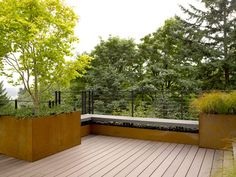 "Corten steel raised bed // Scot Eckley Inc. interesting black fence as well, as the ""flooring"""