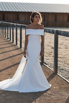Aubrey off the shoulder wedding dress | One Day Bridal CHOSEN – New Reign Collection 2018 | Aubrey is all about the back. A stunning soft tulle tie completes this otherwise structured bridal gown.