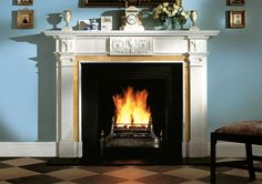 THE BLENHEIM MANTEL The Blenheim is a grand mantel in the style of William Chambers. It has fluted pilasters with Ionic capitals and a frieze which incorporates a central tablet with an urn and foliage.