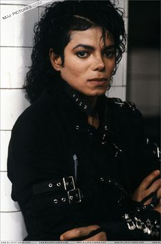 michael jackson bad video attire leather black jacket with buckles and zippers leather pants with buckles and red zlippers with black boots and buckles