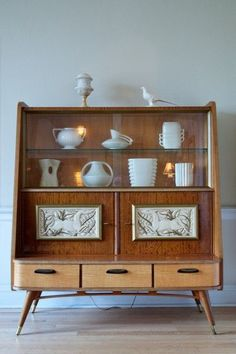 Found this gorgeous mid-century hutch at the awesome Strange Closets ...