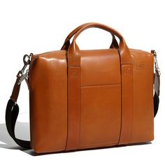 Dad will be the envy of his office with this classic Davis Leather Briefcase from Jack Spade. A clean, streamlined briefcase crafted from smooth vegetable-tanned leather. Double handles and a removable shoulder strap provide convenient carrying options.-SR