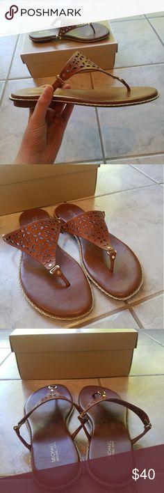 Michael Kors Brown Leather Sandal -Michael Kors flat brown leather Sandal                                       -Gold details                                                                                -Size 9                                                                                      -Gently worn Michael Kors Shoes Sandals