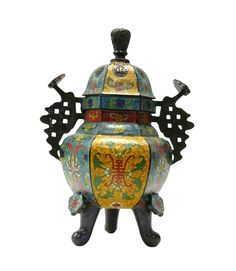 "This is a hand made precise Cloisonne Metal incense burner with three legs simple handle. The body is in blue / yellow base color and oriental wire color pigment is inset around. Dimensions: 10.5"" x 8"