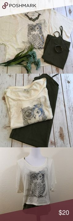 Cream owl crop top Crop top! This top is amazing. So cute and flows great. Comes with an olive colored tank top! The owl is different colors and has a very slight shimmer. Only worn a couple times. ariz Arizona Jean Company Tops Crop Tops