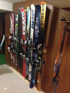 Ski Storage Rack:  9-position ski storage rack and ski pole organizer for ski storage in your garage, basement or ski locker.  See www.buttonskirack.com