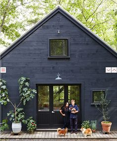 I adore dark grey/black houses, especially slightly industrial in detail and with weathered grey decking.