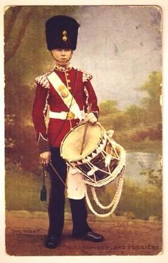 An Edwardian postcard of a drummer boy from the Northumberland Fusiliers.